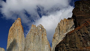Panning shot of Torres del Paine rock towers, Torres del Paine National Park, Patagonia, Chile.  -  Ashley Cooper