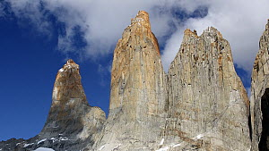 Clouds moving over Torres del Paine rock towers, Torres del Paine National Park, Patagonia, Chile.  -  Ashley Cooper