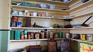 Zoom out of kitchen area in Station W, a former British scientific research station, left as it was after researchers evacuated in 1959, Detaille Island, Graham Land, Antarctica, 2020.  -  Ashley Cooper
