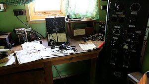 Zoom out of radio room in Station W, a former British scientific research station evacuated in 1959. Detaille Island, Graham Land, Antarctica. 2020  -  Ashley Cooper