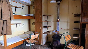 Panning shot of bedroom as it left after researchers evacuated in 1959. Station W, a former British scientific research station. Detaille Island, Graham Land, Antarctica, 2020.  -  Ashley Cooper