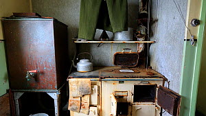 Panning shot of kitchen as it left after researchers evacuated in 1959. Station W, a former British scientific research station. Detaille Island, Graham Land, Antarctica, 2020.  -  Ashley Cooper