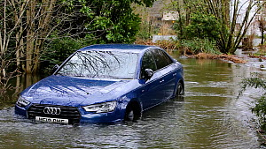 Car partially submerged underwater due to flooding caused by Storm Ciara, Rothay Bridge, Ambleside, Lake District, UK, February, 2020.  -  Ashley Cooper