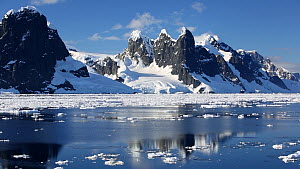 Tracking shot of Antarctic scenery surrounding the Lemaire channel, between Booth Island and the Kiev Peninsular from Peterman Island.  -  Ashley Cooper