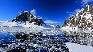 Passing through the Lemaire Channel on an ice-strengthened expedition ship between Booth Island and the Kiev Peninsular, Antarctica.  -  Ashley Cooper