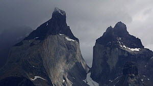 Zooming out of clouds blowing over the Paine massif in high winds, Torres del Paine national park, Patagonia, Chile.  -  Ashley Cooper