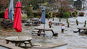 Outdoor tables in Wateredge Hotel beer garden partially submerged underwater due to flooding after Storm Ciara at Lake Windermere, Ambleside, Lake District, UK, 2020.  -  Ashley Cooper