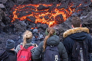 Icelandic people watching and photographing lava at the eruption site, Fagradalsfjall volcano, Iceland, 2 April 2021.  The volcano has drawn an estimated number of 30.000 visitors since the start of...  -  Theo  Bosboom