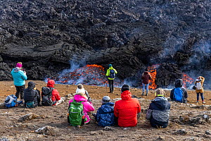 Icelandic people watching and photographing the lava at the eruption site of the Fagradalsfjall volcano, Iceland. 5 April 2021  -  Theo  Bosboom