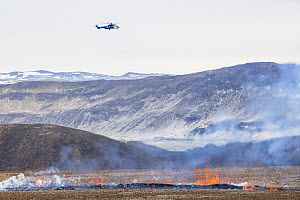 Helicopter hovering over the a new fissure that opened at April 5, 2021, about 700 meters from the original site of the eruption. 5 April 2021  -  Theo  Bosboom