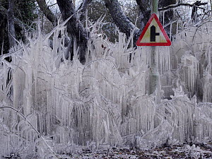Road covered in icicles from splashed flood water, Hertfordshire, England, UK, February  -  Andy Sands