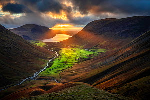 Evening sunlight illuminating Wasdale Head and Wast Water from Great Gable, Lake District National Park, Cumbria, England, UK. December 2020  -  Guy Edwardes
