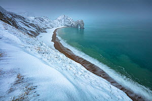 Durdle Door in winter during Storm Emma, Jurassic Coast World Heritage Site, Isle of Purbeck, Dorset, England, UK. March 2018  -  Guy Edwardes