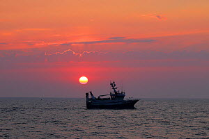 Sunset and fishing vessel 'Harvester', North Sea, August 2020. Property released.  -  Philip  Stephen