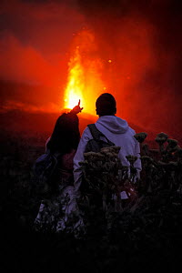 Cumbre Vieja volcano erupting at night, with a couple watching, La Palma, Canary Islands, September 2021.  -  Oriol  Alamany