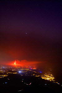 Aerial view of Cumbre Vieja volcano erupting at night, with lava flowing though El Paso village, La Palma, Canary Islands. September 2021.  -  Oriol  Alamany