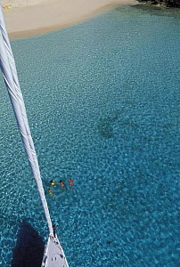 """Aerial view from the masthead of the 88 foot sloop """"Shaman"""", swimmers can be seen below in the clear waters of the Vava'u Group, Tonga, South Pacific.  -  Onne van der Wal"""