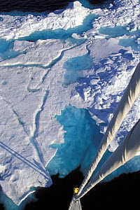 """Masthead view of ice from an 88 foot sloop, """"Shaman"""", in the Norwegian Arctic region of Spitsbergen, Svalbard, Norway. Model and Property Released.  -  Onne van der Wal"""