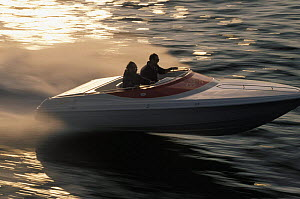 Small speed boat travelling at high speed.  -  Onne van der Wal