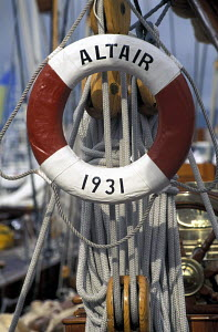 """Traditional red and white life ring bearing the date 1931 aboard the classic yacht """"Altair"""" 1998. - Gary John Norman"""