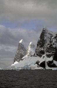 A pair of tall, rounded snow-capped peaks known as Una's Tits (Una was a barmaid from South Georgia during the whalers' days), Lemaire Channel, Antarctica. ^^^ The channel was first navigated by Belgi... - Daniel Allisy