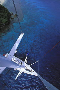 """View of clear waters of the Vava'u group in Tonga from the masthead of the 88ft sloop """"Shaman"""", South Pacific, 2000. Property Released.  -  Onne van der Wal"""
