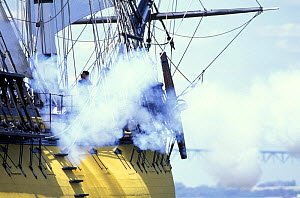 Smoke from a firing cannon on a tall ship.  -  Onne van der Wal