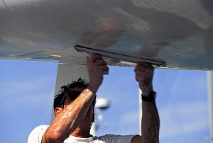 Fairing the hull of a racing yacht to get a smooth hull shape.  -  Onne van der Wal