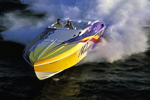Outerlimits high speed powerboat with big wake.  -  Onne van der Wal
