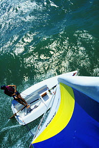 Hiking-out on a Zuma dinghy as seen from the masthead. Model Released and Property Released.  -  Onne van der Wal