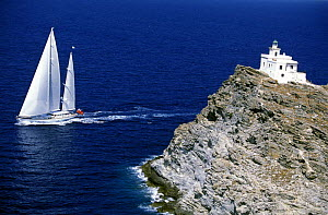 The 147 foot, Dubois superyacht 'Timoneer' sails in the blue waters off a lighthouse in Greece.  -  Rick Tomlinson