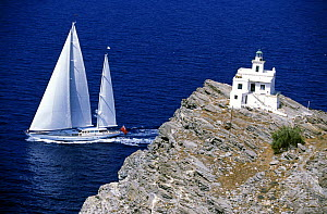 147ft Dubois superyacht ^Timoneer^ sailing in the blue waters off a lighthouse in Greece.  -  Rick Tomlinson