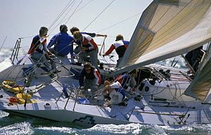 """Crew climb up to the windward rail after a tack aboard """"Amsterdamed"""", Dutch competitor for the Admiral's Cup, 1989. - Rick Tomlinson"""