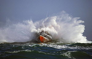 Trent Class relief lifeboat based in Alderney, Channel Islands, breaks through heavy swell in the English Channel.  -  Rick Tomlinson