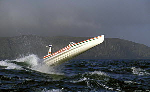 Wave piercing speed boat in rough weather  -  Rick Tomlinson