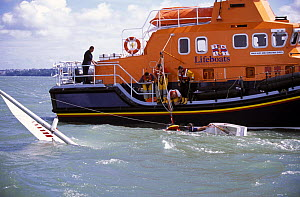 Torbay's Severn Class lifeboat rescues a Sonar during a blustery Cowes Week, UK, 2001. ^^^ The lifeboat was brand new and still in the Solent for her commissioning period before going to her permanent...  -  Rick Tomlinson
