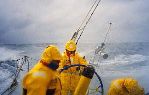 """Crew wearing heavy weather gear in dangerous conditions on """"Intrum Justitia"""" racing in the Round the Whitbread World Race, skippered by Lawrie Smith, 1993-94.^^^ the team won the second leg of the rac...  -  Rick Tomlinson"""