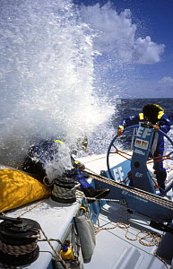 Helmsman is fully geared up in waterproofs on ^EF Language^ Skippered by British yachtsman Lawrie in the Whitbread Round the World Race, 1993-94.~~ ^^^The team won the second leg of the race and broke...  -  Rick Tomlinson