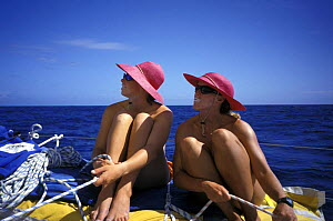 Female crew of ^EF Language^ relax on deck during Whitbread Round the World Race, 1997-98.  -  Rick Tomlinson