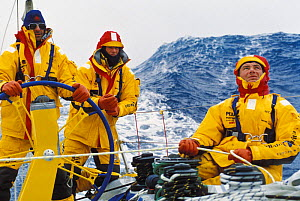 Crew on ^Intrum Justicia^ trimming the spinnaker in heavy Southern Ocean seas in the Whitbread Round the World Race, 1993.  -  Rick Tomlinson