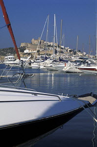 Large powerboats moored in the marina at Ibiza town with the old town in the backround, Ibiza - James Boyd
