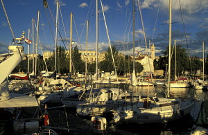 Yachts moored in Pula Marina with Roman amphitheatre in the background, Pula, Slovenia - James Boyd