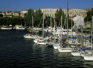 Boats moored in the marina with amphitheatre in the background, Pula, Slovenia - James Boyd