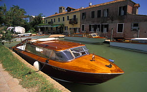 Old wooden motorboat, the type that is often used as taxi boats in the Venetian lagoon. Here infront of Cipriani Inn (locanda Cipriani), Torcello island, Venetian lagoon, Italy.  -  Roberto Rinaldi