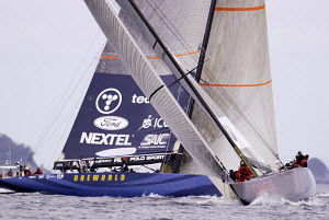"""""""Oneworld"""" (USA-67) and """"Oracle BMW"""" (USA-76) racing in the Semi Final Repechage, Race 3, Louis Vuitton Cup 2002/2003, Auckland, New Zealand. ^^^Oneworld"""" (USA-67) started behind with one penalty and... - Franck Socha"""