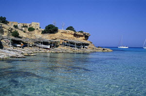 Fishing boat shelters on the shore of the island of Formentera, Ibiza.  -  James Boyd