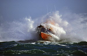 Alderney, Channel Islands Lifeboat covered in spray as it crashes through heavy seas.  -  Rick Tomlinson