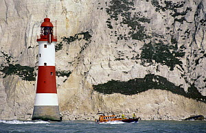 Eastbourne Lifeboat passes the Beachy Head Lighthouse. Beachy Head rises 162 metres (530 feet) above the sea below and is the highest chalk sea cliff in Britain, this is the most famous part of the Ea...  -  Rick Tomlinson