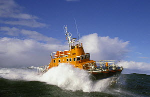 Fishguard, Wales Lifeboat heads out to sea in heavy weather. Designed to lie afloat at deep water moorings or at berth.^^^ The sheerline sweeps down for ease of survivor recovery and the hull is of a... - Rick Tomlinson