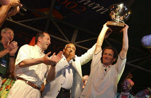 "Michel Desjoyeaux being applauded as he holds up his trophy after winning the 2002 Route du Rhum, Point a Pitre, Guadeloupe. - For EDITORIAL use only.^^^He arrived in his ORMA 60ft trimaran ""G�ant"" af...  -  Yvan Zedda"